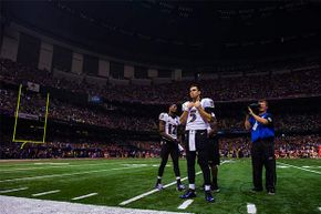 Joe Flacco, No. 5 of the Baltimore Ravens, looks on during the power outage in the third quarter of Super Bowl XLVII against the San Francisco 49ers in New Orleans in 2013. Some Ravens players think the blackout happened on purpose.