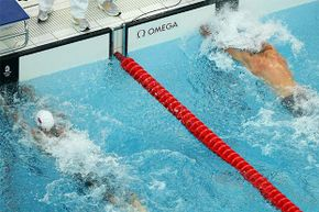 Milorad Cavic of Serbia (L) and Michael Phelps of the United States reach for the wall in the men's 100m Butterfly Final  at the Beijing Olympics. Who really won?