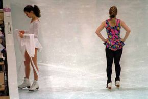The body language says it all: Nancy Kerrigan (left) stays clear of her rival Tonya Harding during a practice session at the 1994 Winter Olympics.