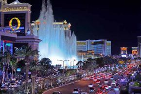 A night view of the Bellagio hotel fountains and the traffic on South Las Vegas Boulevard.