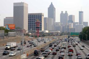 In view of the Olympic torch, traffic crawls through downtown Atlanta along Interstate 75/85 during rush hour.