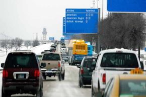Heavy traffic fills the road at Dallas/Fort Worth International Airport after snowfall in Feb. 2011.