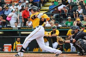 Right fielder for the Pittsburgh Pirates, Travis Snider, drives a hit during a spring training game against the New York Yankees at McKechnie Field in Bradenton, Fla. See more baseball pictures.