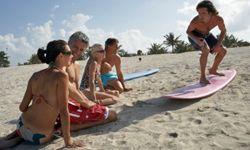 Learn a new sport like surfing.