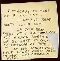 A hidden letter that Aldrich Ames left at a dead drop for his KGB contact