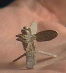 A model of a micromechanical flying insect sitting in the palm of a Berkeley researcher's hand