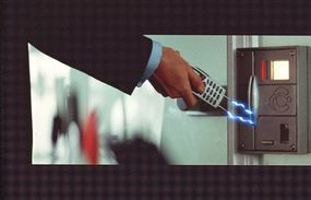 """Bond can do much more than talk on this mobile phone in """"Tomorrow Never Dies."""""""