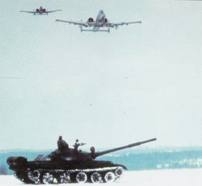 American A-10 Warthog attack jets swoop over a Soviet T-62 Tank.