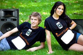 Those snazzy shirts are one of telecom firm Orange's efforts to build eco-friendly phone chargers. The white rectangles on the shirts are the piezoelectric films.
