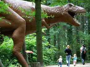Visitors at the Dinosaur Park in Kleinwelka, Germany, walk past the mockup of a Tyrannosaurus. If this T. rex were real, would they need to run? See more dinosaur pictures.