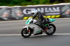 """Motorcycle Image Gallery Isle of Man resident Chris Heath won the TTXGP Open Class in 2009 riding the #21 Electric Motorsport """"Native TTXGP."""" See more pictures of motorcycles."""