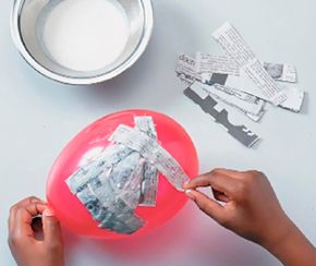 Dip the strips in paste and cover the balloon.