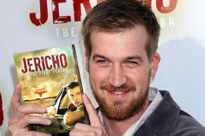 'Jericho' star Kenneth Mitchell poses with a copy of the first season DVD. U.S. government officials ordered the program canceled because of the second season storylines. Just kidding.
