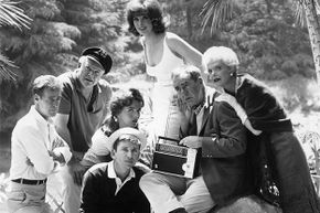 At least this theory seems plausible: Mr. Howell paid Gilligan and the Skipper to do a drug deal at sea. The Professor is a former jailbird and Ginger has a drug habit she picked up in Hollywood; Mary Ann is really a federal agent spying on them. That's why everyone packed so many supplies for a three-hour tour.