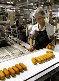 A worker in Schiller Park, Ill., prepares Twinkies for packaging.