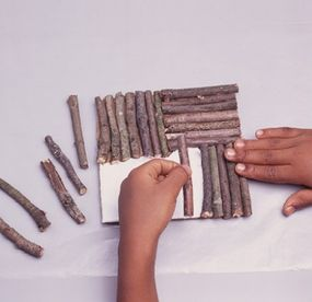 Lay the sticks in a parquet pattern.