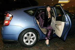 Image Gallery: Hybrid Cars Actress Anjelica Huston arrives at the Costume Designers Guild Awards in a Toyota Prius, a parallel type of hybrid. See more pictures of hybrid cars.