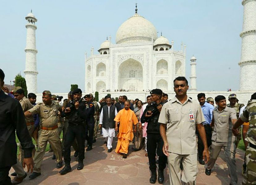 uttar pradesh chief minister yogi adityanath walks with a group in front of the taj mahal