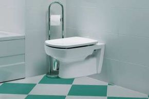 Tankless toilets can conserve water and take up less space than standard models. See more pictures of green living.