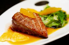 Tasting menu courses are small in size but not in flavor. Play with complimentary tastes, like bright citrus and greens with rich, gamey duck.