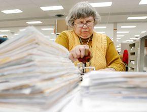 Kathleen Malone works on tax returns at the Cincinnati Internal Revenue Service Center on April 8, 2005, in Covington, Kentucky.
