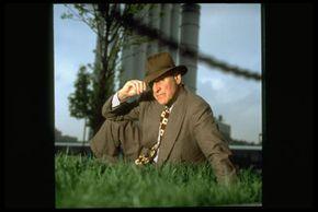Bond dealer Jim Lebenthal sits in front of a sewage treatment plant financed by municipal bonds.