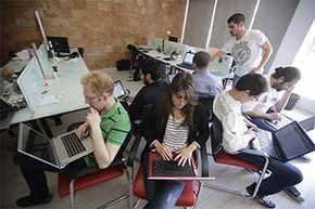 Lebanese entrepreneurs from different Internet startup companies work in the offices of accelerator Seeqnce in Beirut. The setup for startup accelerators is similar the world over.