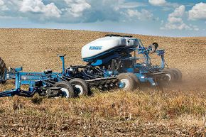 This multi-hybrid planter allows farmers to change seed type right in the middle of planting.