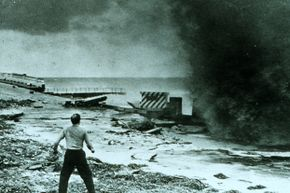 A startled man gets ready to run after a hurricane-driven wave smashes into a seawall in 1947. See more storm pictures.