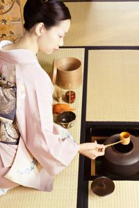 A woman performing a tea ceremony