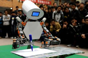 A robot shows its writing skills during a contest of intelligent robots created by college students at China's Anhui University of Science and Technology on Nov. 16, 2012.