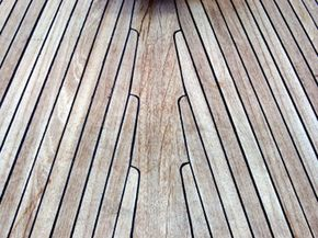 Teak weathers into a nice silver gray finish. Its durability make it a great material for outdoor applications like this yacht's deck.