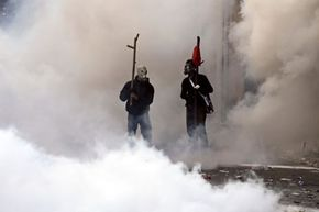 Demonstrators clash with police during a protest against plans for new austerity measures on Oct. 20, 2011, in Athens, Greece.