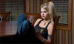 Warn your teenager about the risks associated with tattoos and piercings.