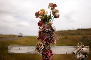A cross marks the spot in Nunn, Colo., where a person died in a car crash. Memorials like this dot the U.S. Are more of them for teens than adults?