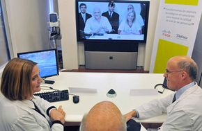 Doctors teleconference to help patients virtually.
