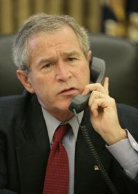 President Image Gallery Country-specific calling codes let callers make international calls such as this one made by President George W. Bush to Chinese President Hu Jintao. See more pictures of U.S. Presidents.