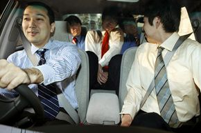 By car pooling, a group of Tokyo businessmen get to save gas and enjoy each others' company.
