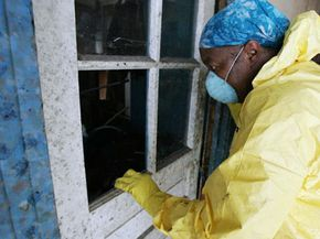 Luella Pinkney looks through a mold covered window as she gets her first look at her house in October 2005, more than a month after Hurricane Katrina. See more pictures of hidden home dangers.