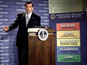The first Homeland Security Secretary Tom Ridge unveils a color-coded terrorism warning system on March 12, 2002, in Washington, D.C.