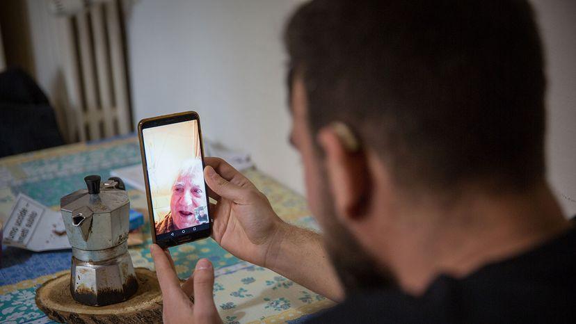 talking with grandfather via WhatsApp