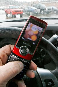 A cell phone is held in a vehicle in Berlin, Vt.