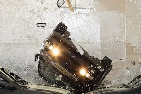Hollywood movie stuntman Rock Taylor drives through a huge sheet of glass at the 02 Arena in London.