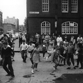 Chubby Checker's hit and related follow-ups had folks Twisting all over the world. These kids in Shoreditch, East London, Twisted during recess.
