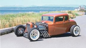 Don Tognotti's The Avenger was built on a 1932 Ford coupe and is painted Aztec Golden Copper. See more hot rod pictures.
