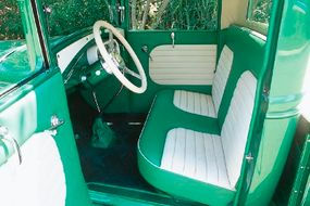 Note The Grasshopper's handmade dash and upholstery stitched by Little John of Metalcrafters, Inc.