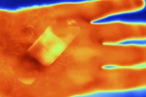 Thermal image of a hand with and adhesive bandage on it.