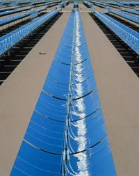 Parabolic troughs collect heat for a solar power plant in Mojave Desert, California.
