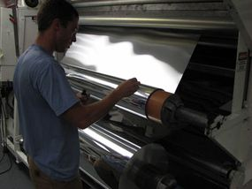 Staff Engineer Addison Shelton works with a solar cell production coater at Nanosolar.
