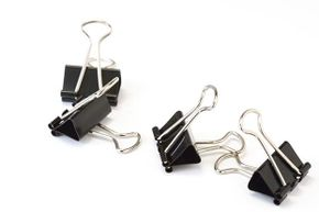 Binder clips are prized for their strength — if you ever had a fingertip caught in one of these suckers, you know what we mean. That strength makes them great for coralling cords.